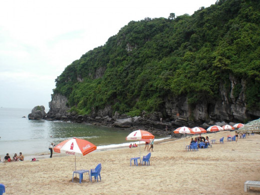 The beach serves sun seekers whilst umbrellas spread over the place for ya to hide and dry.