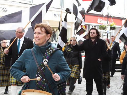 Parade in Cornwall with Cornish flag - black with white cross.