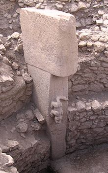 close up of T-shaped monolith with animal.