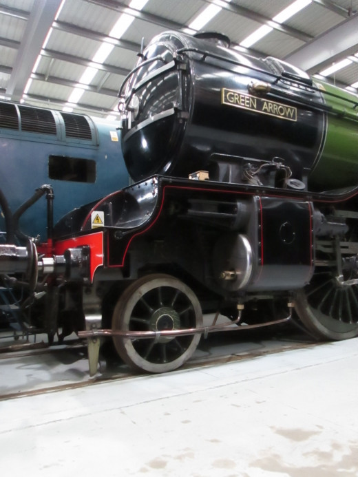 A look up at the smokebox of 4771 with the nearside cylinder and brass nameplate - behind is the Deltic in original blue livery with 'speed whiskers'
