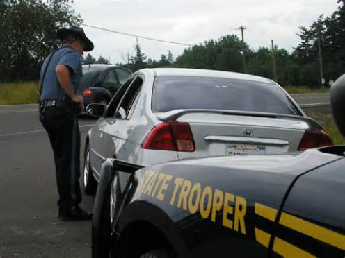 A State Trooper trying to endure your foolish antics.