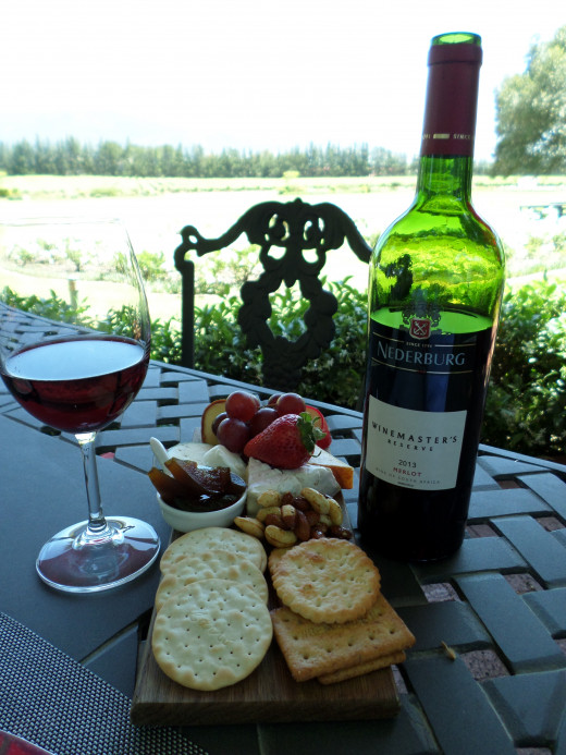 Cheese platter and a bottle of Nederburg, Cabernet Sauvignon - Wine Masters Collection