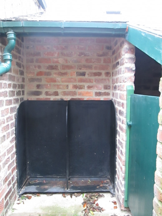 The original cast iron gents urinals - seated cubicle to the right