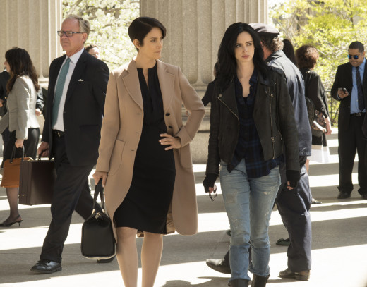 Hogarth (played by Carrie-Anne Moss) and Jones