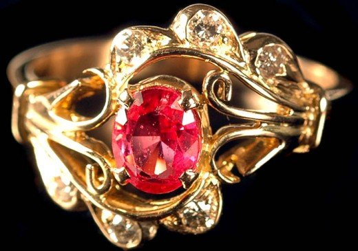 A unique ruby ring design accented with smaller diamonds