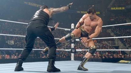 Del Rio aims a kick at Reigns.