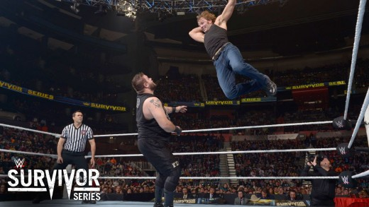 Ambrose aims a flying elbow drop at Owens.