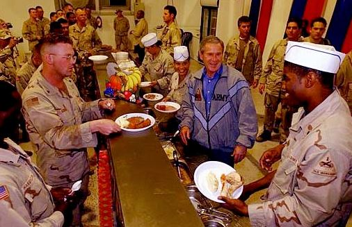 Former US President George W. Bush celebrating Thanksgiving with American soldiers in Iraq in November 2003.