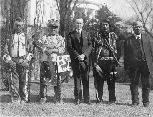 Osage men with American President Calvin Coolidge after signing the Indian Citizenship Act of 1924.