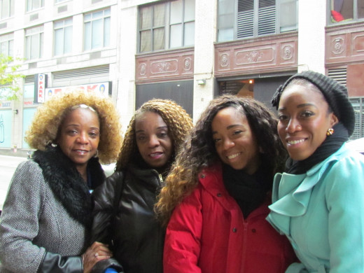 My daughters, Wanisha & Jaleesa and my twin sister Paulette outside the Wendy's studio.