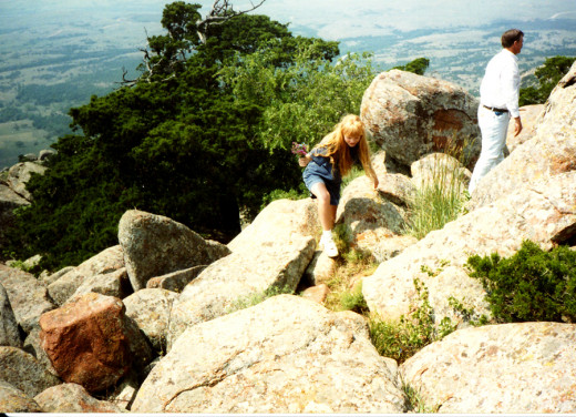 climbing over rocks at the top of Mount Scott in Oklahoma