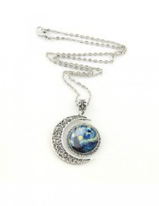 I really love this necklace!  It's a Starry Starry Night with the TARDIS in it.