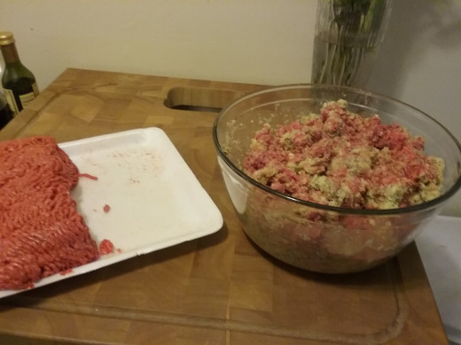 Add the ground beef to the bread mixture about a half pound or so at a time and mix it well with your hands.