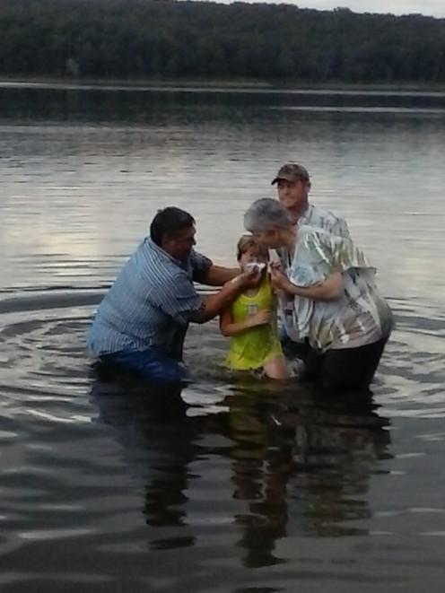 Alana getting baptized.