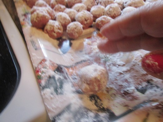 Rolling them in the flour after being dusted on top.