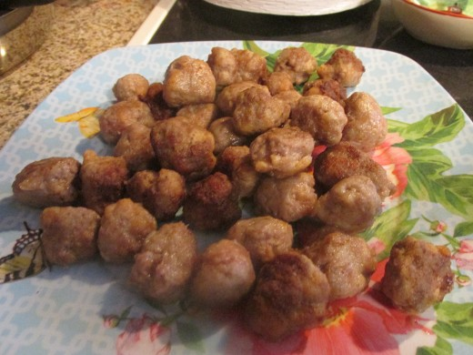Browned meatballs before the gravy.