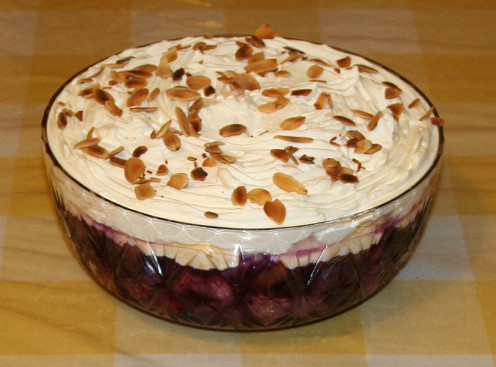 An English trifle dessert made with sherry, sponge, fruit, custard and cream layers.