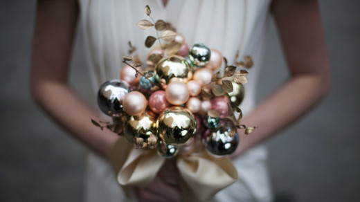 Some flowers would not be able to hold up well in the winter time. The Christmas ornaments as a bouquet is clever idea.