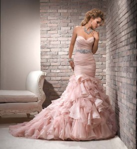 Pink is nice idea for a wedding dress. Something outside is of the box for a offbeat and nontraditional ride.