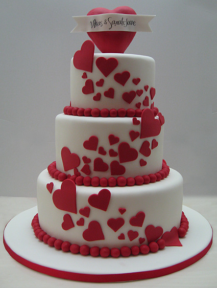 Red hearts on your wedding would go perfectly with a Valentine's Day themed wedding.