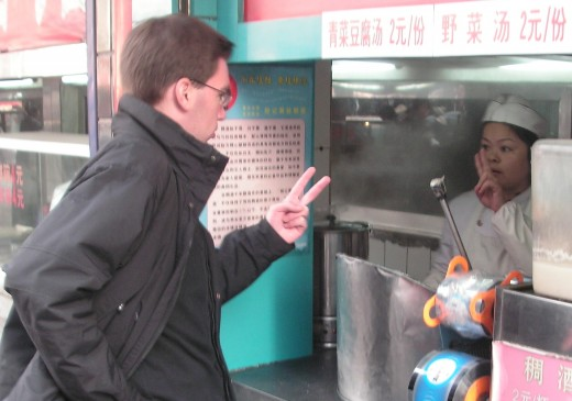Understanding each other; seen in a street near the bell tower of Xi'an, China.  Nonverbal communication represents two-thirds of all communication.