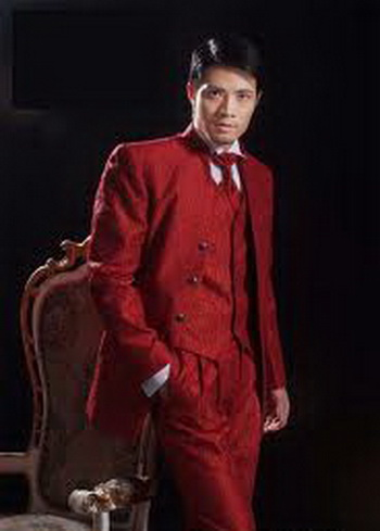 This red groom suit has a very festive look.