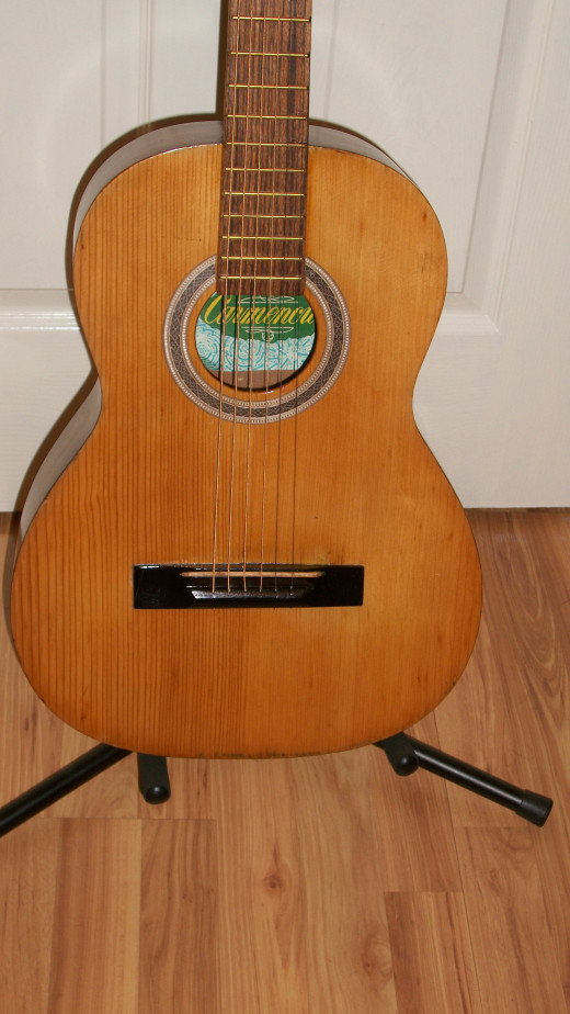 I used the original bridge but will add a bone saddle. The frets are the original and were cleaned with fine sandpaper.