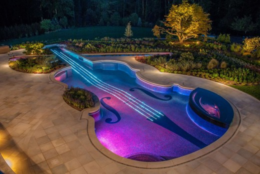 Look - a giant glowing violin at night! Sweet music follows.
