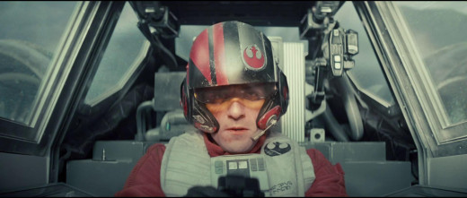 Resistance pilot Poe Dameron (Oscar Isaacs) behind the controls of his personalized X-Wing Fighter.
