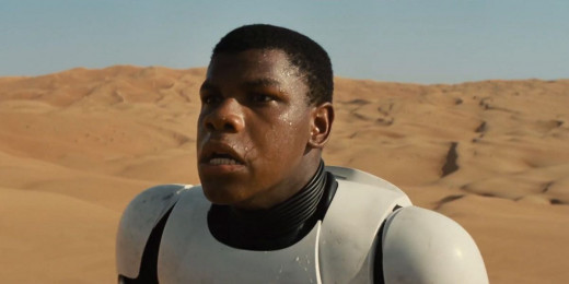Finn (John Boyega) awakens after crashing on Jakku.