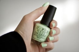 O.P.I. and Essie Nail polish bottles. Both brands are high quality nail polish that is guaranteed not to chip easily.