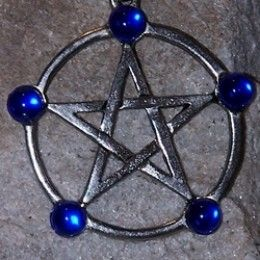Yes, my oft-used pentacle intro. Usuaully hanging on my computer to keep me balanced, it reminds me the season is not about body-slamming people in crowded stores or getting stuck in traffic.