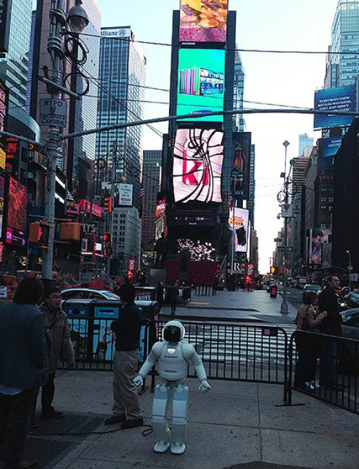 ASIMO visited New York in 2014. Surprisingly, he's the least sci-fi thing about this image.