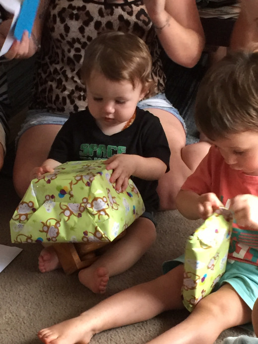 Grandsons Dylan and Jordan opening presents