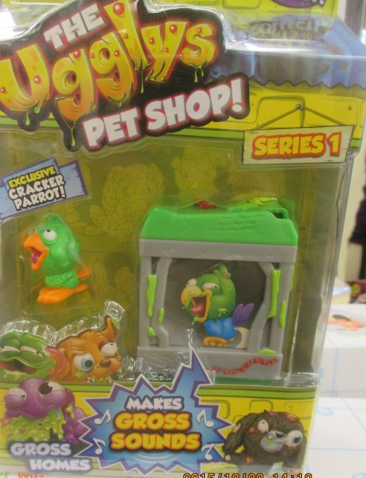 """Ugglys Pet Shop"" featuring Cracker Parrot and his ""gross sounds""- a lovely holiday gift.  At least it beats surprising some unprepared and uninformed person with a REAL parrot. - Photo by George Sommers"