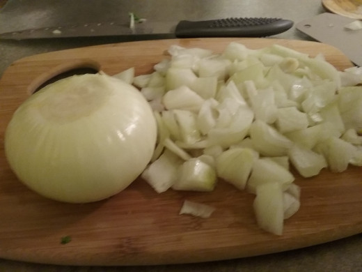 Roughly chop 2 large onions. I use Vidalia, but yellow or white will also do.