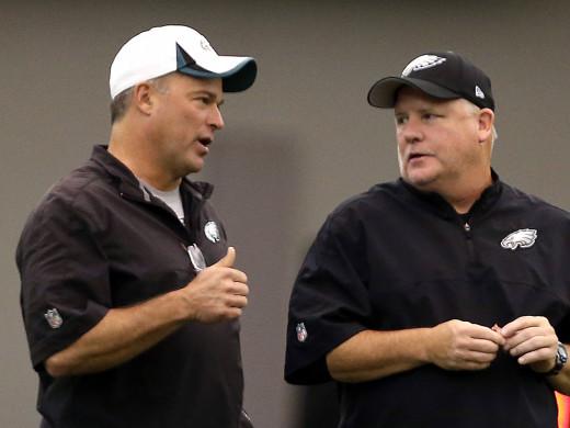 Philadelphia Eagles Defensive Coordinator Bill Davis (L) and head coach / GM Chip Kelly (L) should both be fired