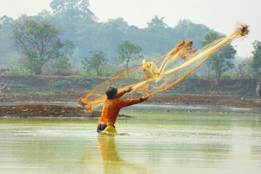A fisherman spreading his net.