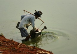 Gallons of lake water were carried on his shoulder to water his field before planting.