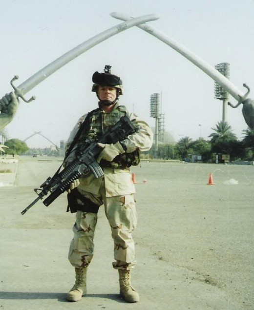 US Soldier Stands Guard In Baghdad.