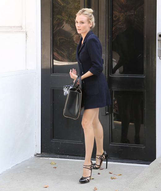 Diane Kruger stylish in a little black dress and stilettos