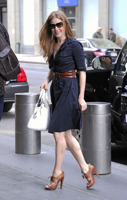 Amy Adams street style in a navy dress showing off her shapely legs in booties