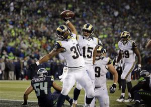 Todd Gurley spikes the football after scoring his 10th touchdown of the season.