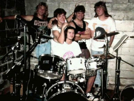 The band I was in during my late teens.  I'm in the back at the left.  What can I say?  It was the era of glam metal in the States.