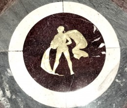 Aquarius, pouring out knowledge for all humanity. All 12 signs of the zodiac are inlaid, in brass, in the marble floor of the Library of Congress, Washington, D.C.