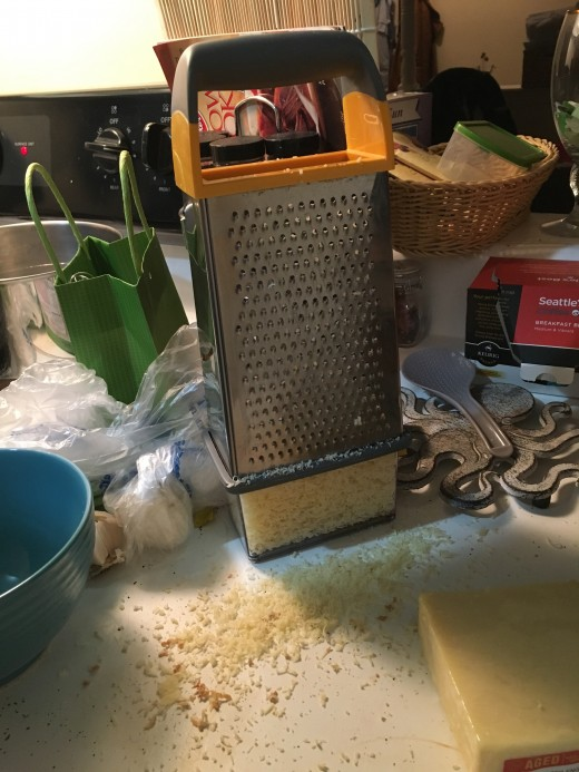 There is a lot of cheese to grate, so if you have someone that would like to help out in the kitchen it will save you a lot of time to have them grate the cheese.