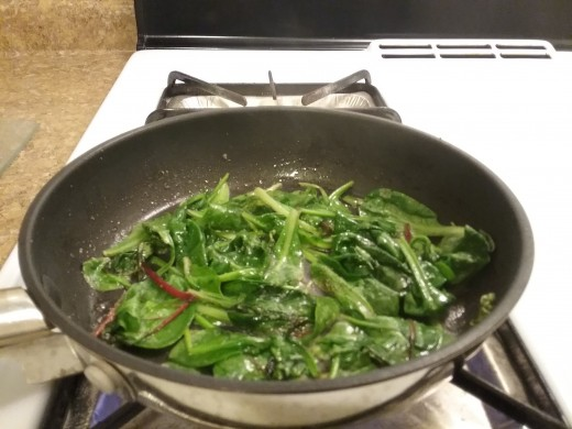 Greens are ready when they are wilted, but not mushy. Stir them up a little but leave them spread out in pan.