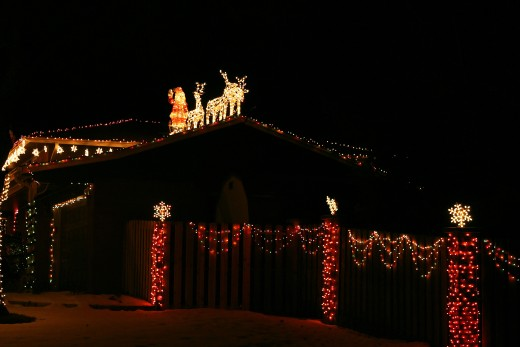 Santa, his reindeer, and lighted candles are features of this house on Prince Street.