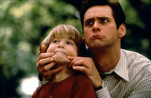 "Cooper (left) and Carrey (right) can't keep a straight face in ""Liar Liar"""