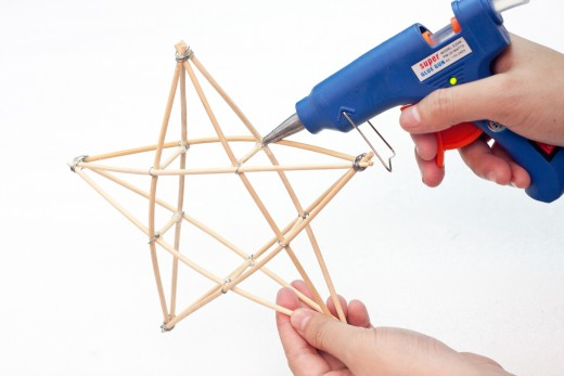 Use a hot glue gun to connect and secure the wood pieces.